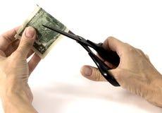 Tagli i vostri soldi in due Fotografia Stock Libera da Diritti