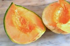 Tagli il cantalupo del melone immagini stock libere da diritti