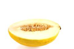 Tagli il melone isolato su bianco. Immagini Stock