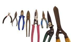 Tagli l'accumulazione delle tenaglie dei pincers degli strumenti su bianco Fotografia Stock