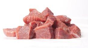 Tagli la carne cruda su fondo bianco Fotografia Stock