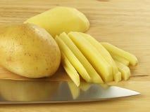 Tagli la patata Fotografie Stock