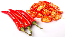 Tagli le fette di Chili Peppers rosso II Immagine Stock