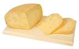 Tagli le porzioni di formaggio Gouda cumino-condetto Fotografie Stock Libere da Diritti
