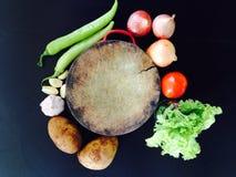 tagliando ed alimento orgnaic su fondo nero Fotografie Stock Libere da Diritti