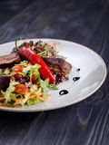 Tagliata of beef with salad on a plate Stock Photos