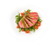 Tagliata tuna with arugula and cherry tomatoes Stock Images