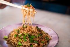 Tagliatella fritta con la minestra della costola di carne di maiale Fotografie Stock