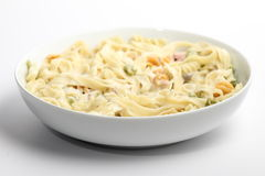 Tagliatelle. Ham and mushroom tagliatelle in a white bowl with whote background royalty free stock photography