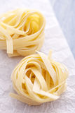 Tagliatelle. On a blue table Royalty Free Stock Photos