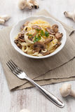 Tagliatelle ai funghi - Noodles with mushroom Royalty Free Stock Image