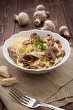 Tagliatelle ai funghi - Noodles with mushroom Royalty Free Stock Photography