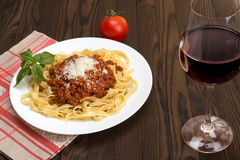Tagliatelle al ragu Bolognese and wine Chianti Royalty Free Stock Images