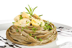 Tagliatelle with artichoke and fresb herbs. Royalty Free Stock Photography