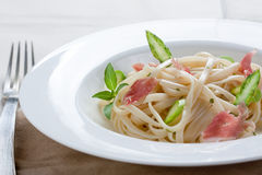 Tagliatelle with asparagus and ham Stock Photo