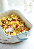 Tagliatelle baked with vegetables and parmesan Royalty Free Stock Photo