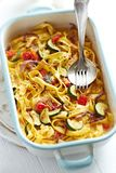 Tagliatelle baked with vegetables and parmesan Stock Photography
