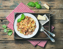 Tagliatelle Bolognese with Parmesan and basil in wooden tray Royalty Free Stock Photography