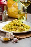 Tagliatelle with chicken curry, leek and garlic Stock Images