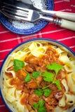 Tagliatelle with dark sauce. Stock Image