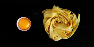 Tagliatelle and egg yolk Royalty Free Stock Photography