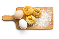 Tagliatelle, eggs and flour Royalty Free Stock Photography