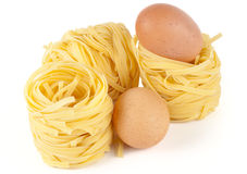 Tagliatelle with eggs isolated on white Royalty Free Stock Image