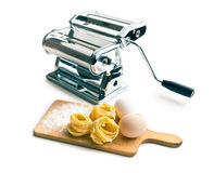 Tagliatelle,eggs and pasta machine Stock Photo