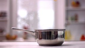 Tagliatelle falling in pot in kitchen stock video footage