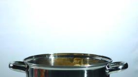 Tagliatelle falling into a saucepan. In slow motion stock footage