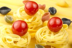 Tagliatelle and fresh tomatoes Royalty Free Stock Photos