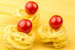 Tagliatelle and fresh tomatoes Stock Photo