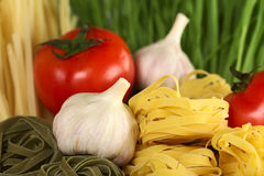 Tagliatelle with Garlic and Tomato Stock Photos
