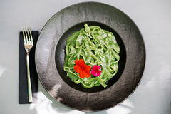 Tagliatelle with green basil pesto Stock Photography