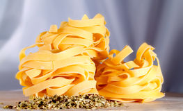 Tagliatelle and herbs in a kitchen Stock Photo