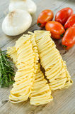 Tagliatelle and ingredients Royalty Free Stock Images