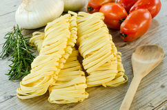 Tagliatelle and ingredients Royalty Free Stock Photos