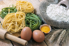 Tagliatelle and  ingredients with background Stock Photography