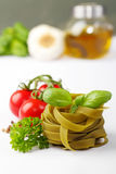 Tagliatelle and ingredients Stock Images