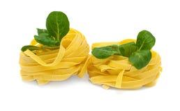 Tagliatelle italien de pâtes avec la mâche Photographie stock