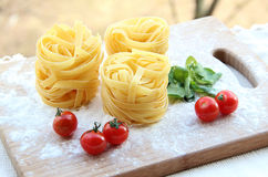 Tagliatelle - italienische Teigwaren Stockbilder
