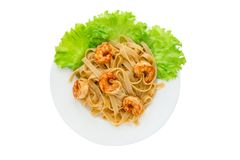 Boiled pasta with fried shrimp. Stock Photo