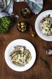 Tagliatelle med kronärtskockor och tioarmade bläckfisken i kräm- sås royaltyfria foton