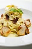 Tagliatelle. With Mushroom, Cream Sauce, Truffle and Basil Leaf Stock Photo