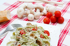 Tagliatelle with mushrooms and cheese Stock Photo