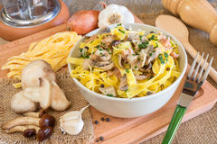 Tagliatelle mushrooms and sausage Royalty Free Stock Photography