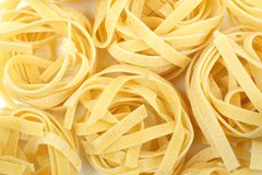 Tagliatelle nest pasta background Stock Photography