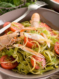 Tagliatelle with norway lobster Stock Photos