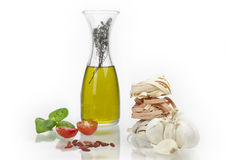 Tagliatelle with olive oil. Tagliatte flavored with olive oil, peppers, tomatoes and garlic Royalty Free Stock Image