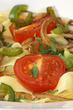 Tagliatelle with organic tomato and herbs Royalty Free Stock Photography